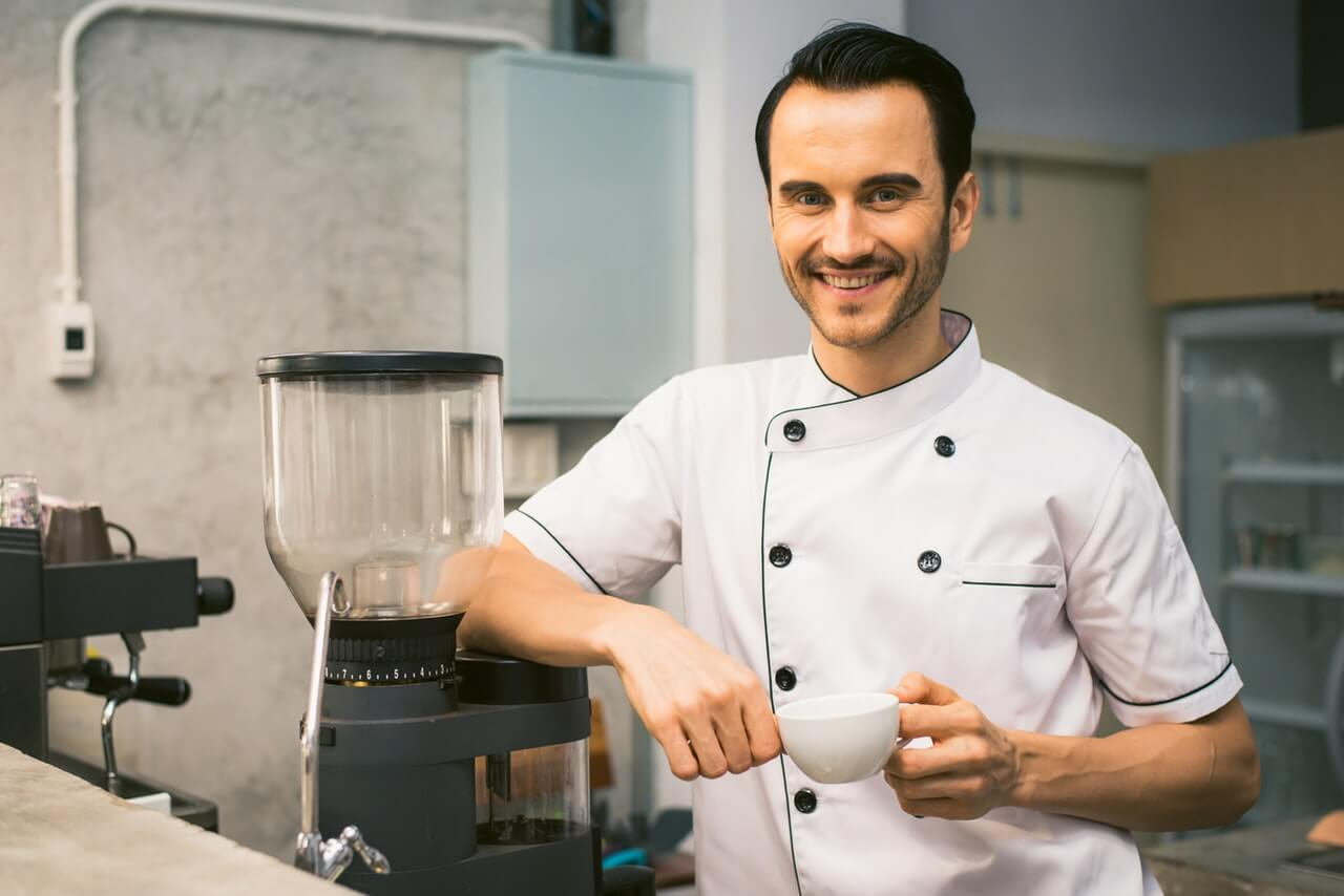 chef-holding-white-tea-cup